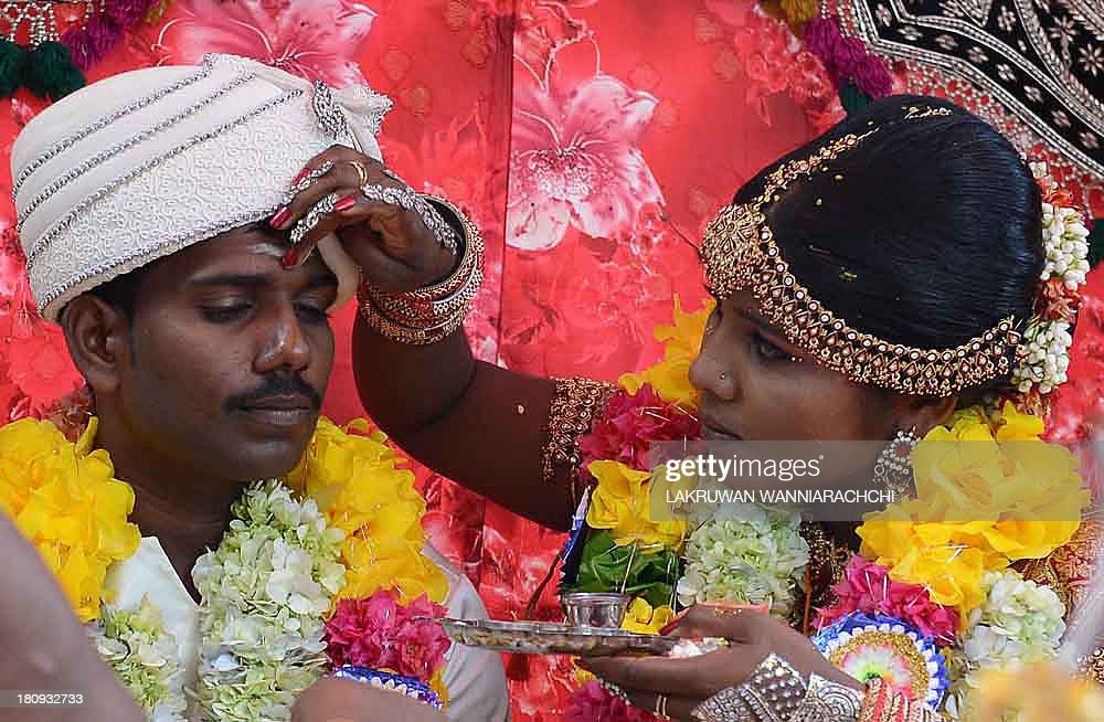 JVarman a former Tamil Tiger and his Tamil bride N Sukitha get married in the northern Sri Lanan town of Kilinochchi Sept 18 at a ceremony arranged...