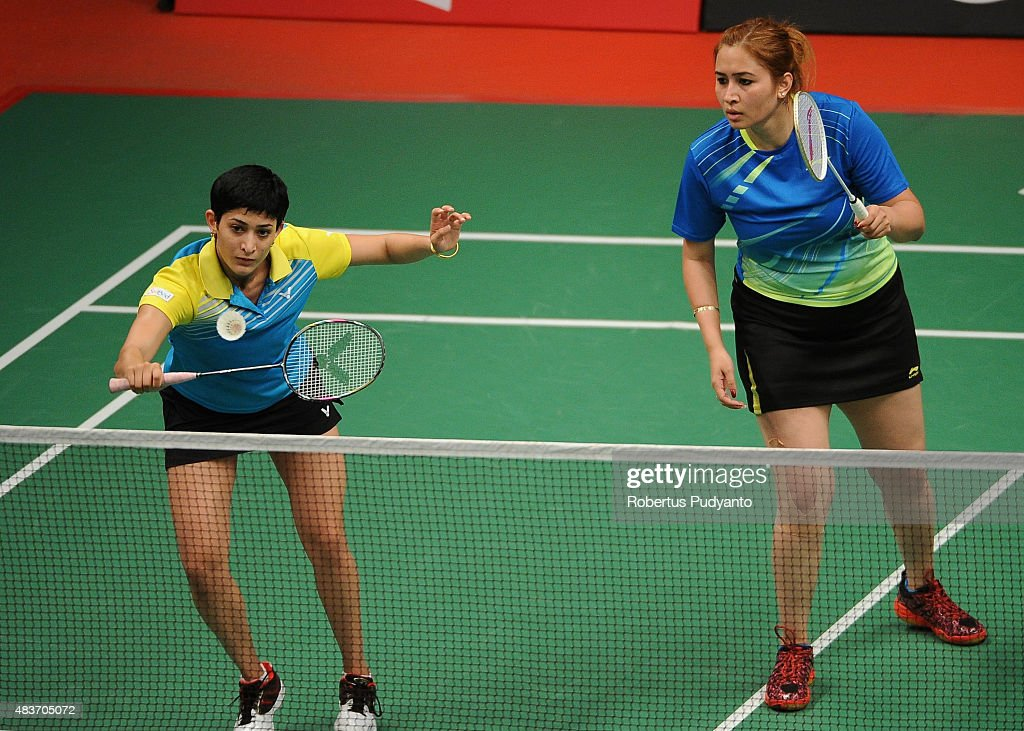 <a gi-track='captionPersonalityLinkClicked' href=/galleries/search?phrase=Jwala+Gutta&family=editorial&specificpeople=795812 ng-click='$event.stopPropagation()'>Jwala Gutta</a> and Ashwini Ponnappa of India compete against Hsieh Pei Chen and Wu Ti Jung of Taipei in the 2015 Total BWF World Championship at Istora Senayan on August 12, 2015 in Jakarta, Indonesia.