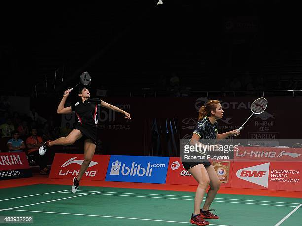 Jwala Gutta and Ashwini Ponnappa of India compete against Naoko Fukuman and Kurumi Yonao of Japan in the quarter final match of the 2015 Total BWF...