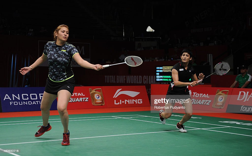 <a gi-track='captionPersonalityLinkClicked' href=/galleries/search?phrase=Jwala+Gutta&family=editorial&specificpeople=795812 ng-click='$event.stopPropagation()'>Jwala Gutta</a> and Ashwini Ponnappa of India compete against Naoko Fukuman and Kurumi Yonao of Japan in the quarter final match of the 2015 Total BWF World Championship at Istora Senayan on August 14, 2015 in Jakarta, Indonesia.