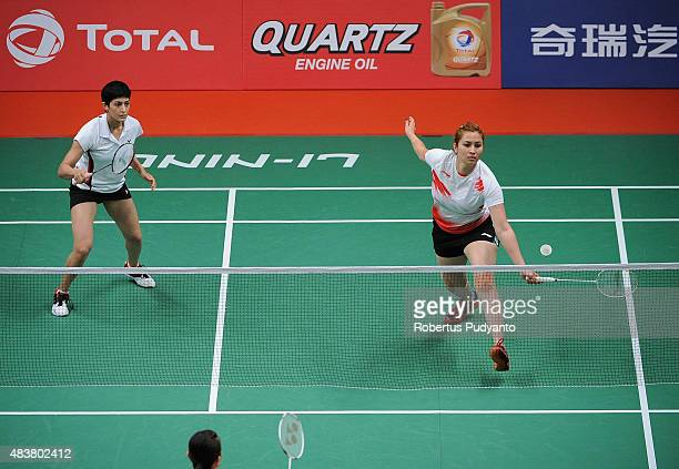 Jwala Gutta and Ashwini Ponnappa of India compete against Reika Kakiiwa and Miyuki Maeda of Japan in the 2015 Total BWF World Championship at Istora...