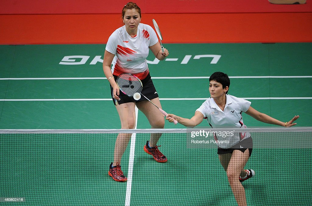 <a gi-track='captionPersonalityLinkClicked' href=/galleries/search?phrase=Jwala+Gutta&family=editorial&specificpeople=795812 ng-click='$event.stopPropagation()'>Jwala Gutta</a> and Ashwini Ponnappa of India compete against Reika Kakiiwa and Miyuki Maeda of Japan in the 2015 Total BWF World Championship at Istora Senayan on August 13, 2015 in Jakarta, Indonesia.