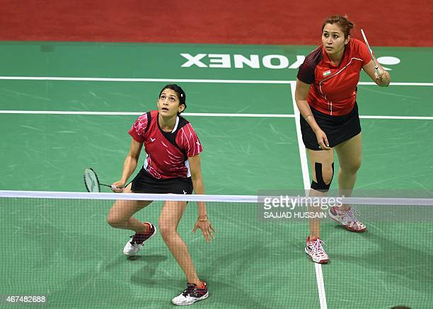 Jwala Gutta and Ashwini Ponnappa of India get ready to return a shot to Ou Dongi and Xiaohan of China during their women's badminton doubles match at...