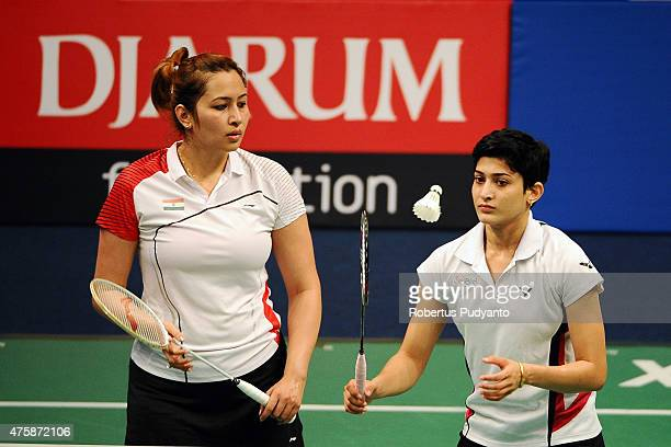 Jwala Gutta and Ashwini Ponnappa of India return a shot against Yu Yang and Zhong Qianxin of China during the 2015 BCA Indonesia Open Round 2 match...