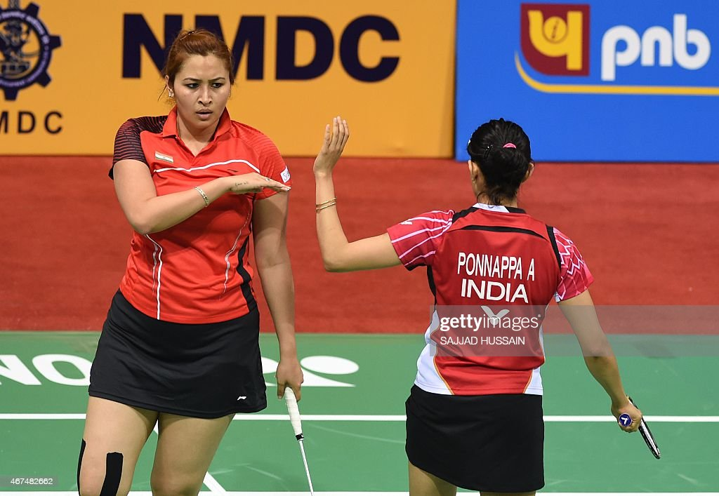 <a gi-track='captionPersonalityLinkClicked' href=/galleries/search?phrase=Jwala+Gutta&family=editorial&specificpeople=795812 ng-click='$event.stopPropagation()'>Jwala Gutta</a> (L) and Ashwini Ponnappa (R) of Indian celebrate after winning a point against Ou Dongi and Xiaohan of China during their women's badminton doubles match at the Yonex-Sunrise India Open 2015 at the Siri Fort Sports Complex in New Delhi on March 25, 2015.