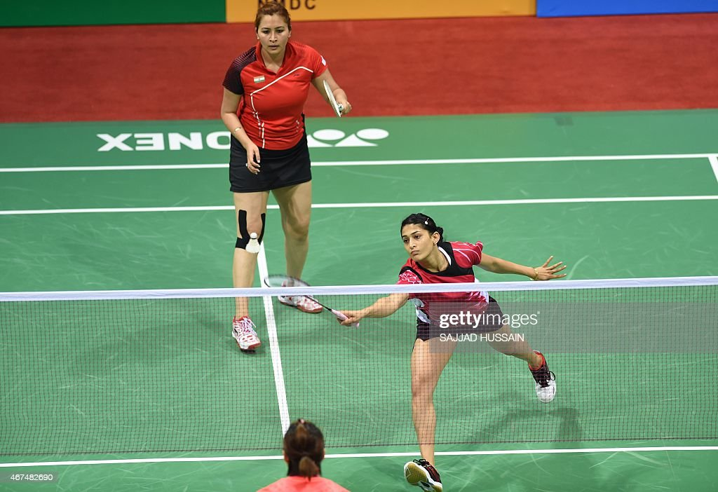 <a gi-track='captionPersonalityLinkClicked' href=/galleries/search?phrase=Jwala+Gutta&family=editorial&specificpeople=795812 ng-click='$event.stopPropagation()'>Jwala Gutta</a> (L) look on as Ashwini Ponnappa (R) of India returns a shot to Ou Dongi and Xiaohan of China during their women's badminton doubles match at the Yonex-Sunrise India Open 2015 at the Siri Fort Sports Complex in New Delhi on March 25, 2015.