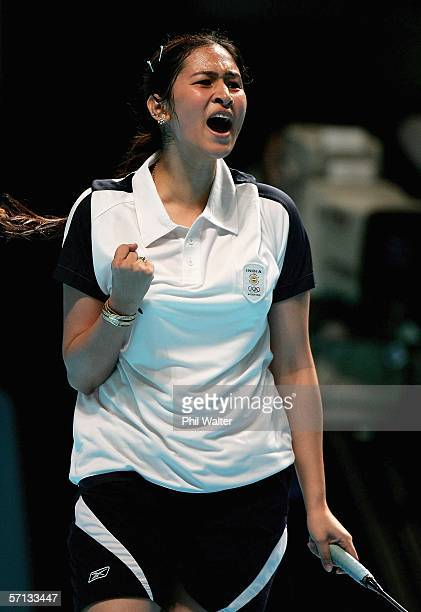 Jwala Gutta of India who was teamed with Valiyaveetil Diju celebrates winning their mixed team badminton match against Dan Shirley and Sara Runesten...