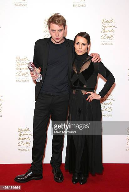 Anderson and Noomi Rapace pose in the Winners Room at the British Fashion Awards 2015 at London Coliseum on November 23 2015 in London England
