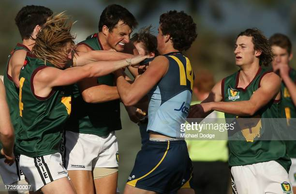 Jydon Neagle of NSW/ACT wrestles with Toby Nankervis of Tasmania during a melee during the round five AFL Under 18s Championship match between...