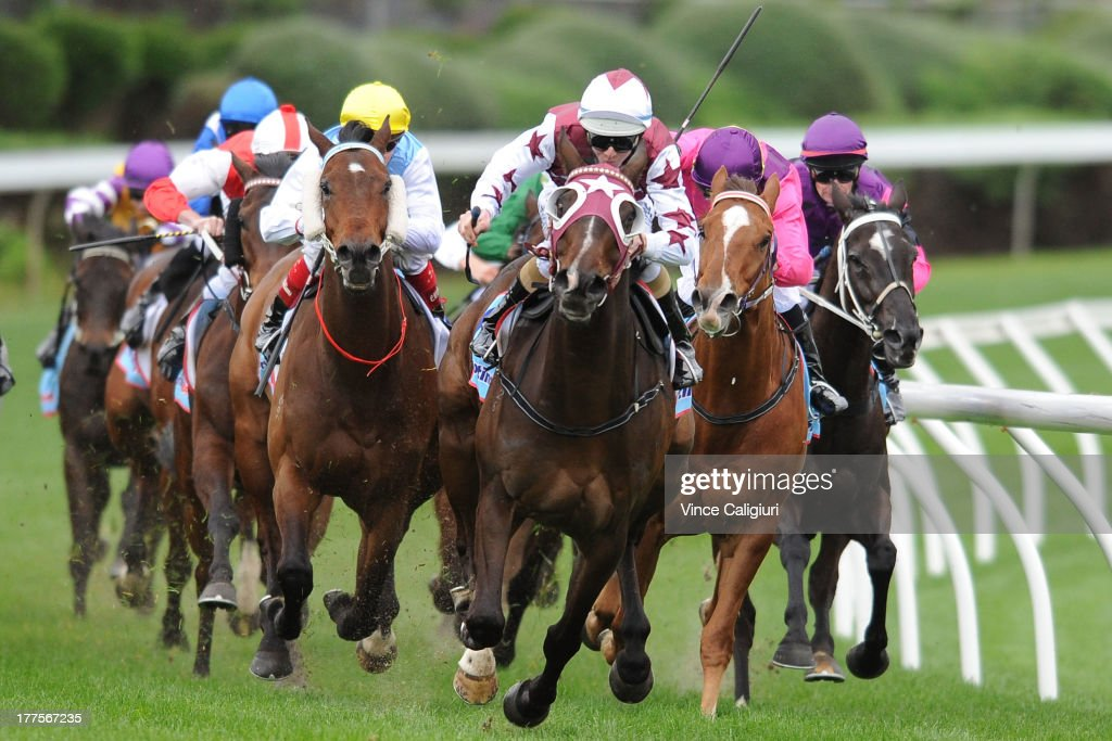 Jye McNeil riding Clang And Bang (ctr) wins the Chandler MacLeod Handicap during Melbourne Racing at Moonee Valley Racecourse on August 24, 2013 in Melbourne, Australia.