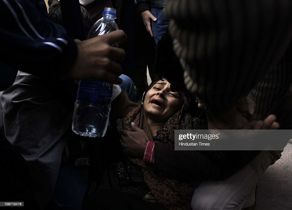 Jyoti, daughter of Delhi Police constable Subhash Chand Tomar wails during funeral rites of her father at Nigambodh Ghat, on December 25, 2012 in New Delhi, India. Subhash Chand died after being injured in a protest against brutal gang rape of a student in a moving bus.