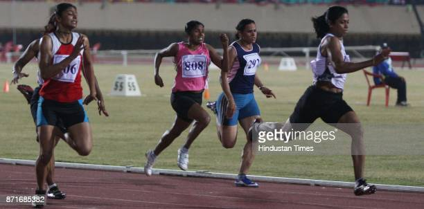 Jyoti of Karnataka leading the 100 meter race and then winning gold at the atheletic event in the Birsa Munda Main Athletic Stadium at Hotwar in the...