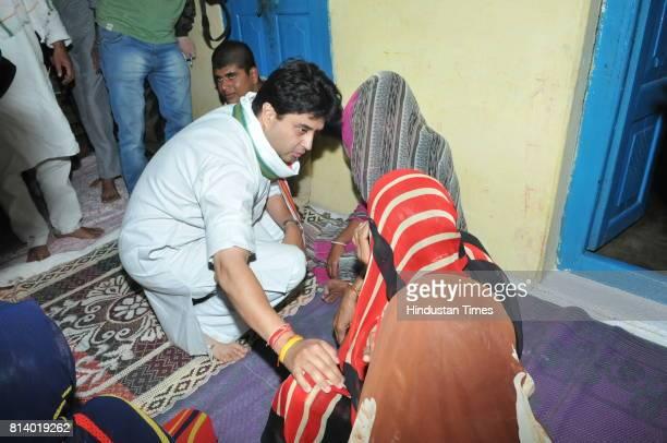 Jyotiraditya Scindia consoling the family members of Shatrunjay Meena at village Gawardia Budhni constituency on July 13 2017 near Bhopal India