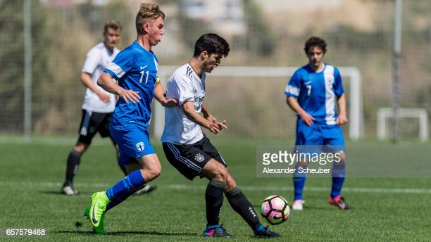 Jyri Kiuru of Finland challenges Elias Abouchabaka of Germany during the UEFA U17 elite round match between Germany and Finland on March 25 2017 in...