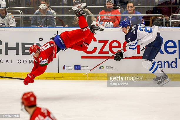 Jyrki Jokipakka of Finland and Artur Gavrus of Belarus battle for the puck during the IIHF World Championship group B match between Finland and...