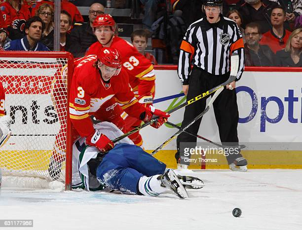Jyrki Jokipakka of the Calgary Flames battles against the Vancouver Canucks at Scotiabank Saddledome on January 7 2017 in Calgary Alberta Canada