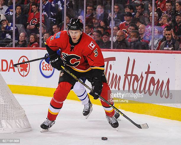 Jyrki Jokipakka of the Calgary Flames in action against the Toronto Maple Leafs during an NHL game at Scotiabank Saddledome on November 30 2016 in...
