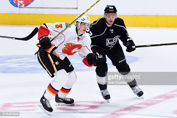 Jyrki Jokipakka of the Calgary Flames skates against Trevor Lewis of the Los Angeles Kings on March 31 2016 at Staples Center in Los Angeles...