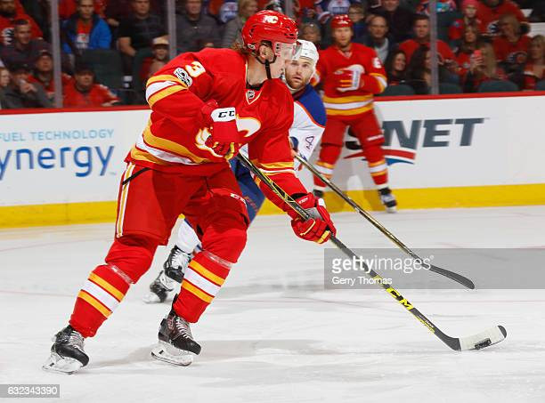 Jyrki Jokipakka of the Calgary Flames skates the puck against the Edmonton Oilers at Scotiabank Saddledome on January 21 2017 in Calgary Alberta...