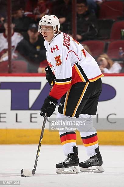 Jyrki Jokipakka of the Calgary Flames skates with the puck during the third period of the NHL game against the Arizona Coyotes at Gila River Arena on...