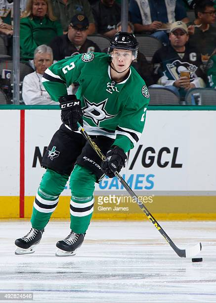 Jyrki Jokipakka of the Dallas Stars handles the puck against the Pittsburgh Penguins at the American Airlines Center on October 8 2015 in Dallas Texas