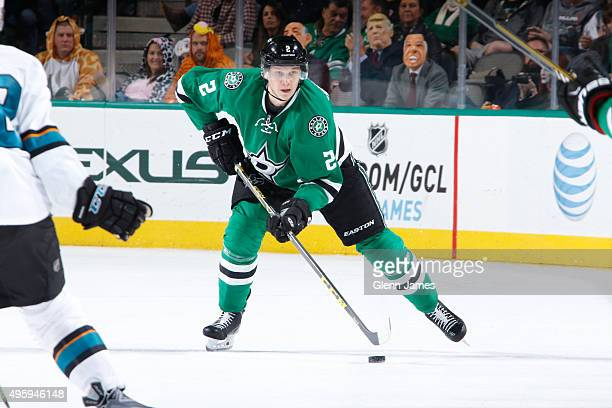 Jyrki Jokipakka of the Dallas Stars handles the puck against the San Jose Sharks at the American Airlines Center on October 31 2015 in Dallas Texas