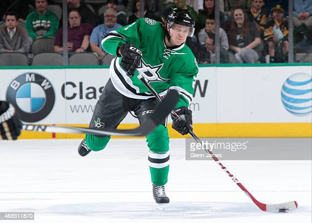 Jyrki Jokipakka of the Dallas Stars makes a pass to a teammate against the Pittsburgh Penguins at the American Airlines Center on March 19 2015 in...