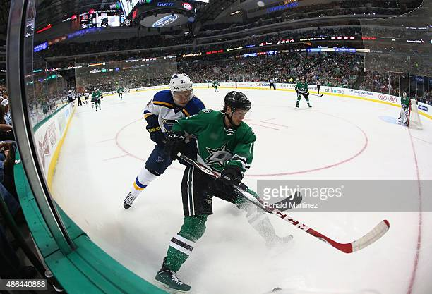 Jyrki Jokipakka of the Dallas Stars skates the puck against Vladimir Tarasenko of the St Louis Blues in the second period at American Airlines Center...