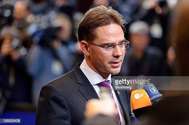Jyrki Katainen Finland's prime minister speaks to the media while arriving to attend a working dinner as part of a twoday summit of European Leaders...