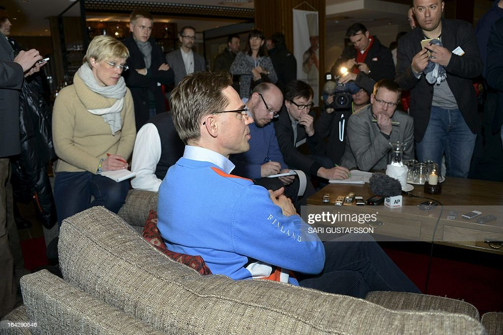 Jyrki Katainen, Finnish Prime Minister (front) talks to the media in Saariselka resort in Inari in Finnish Lapland on March 22, 2013. The Lapland retreat meeting will discuss shifts in the global economy and ways to resolve the economic crisis in Europe. AFP PHOTO/ LEHTIKUVA / Sari Gustafsson FINLAND OUT