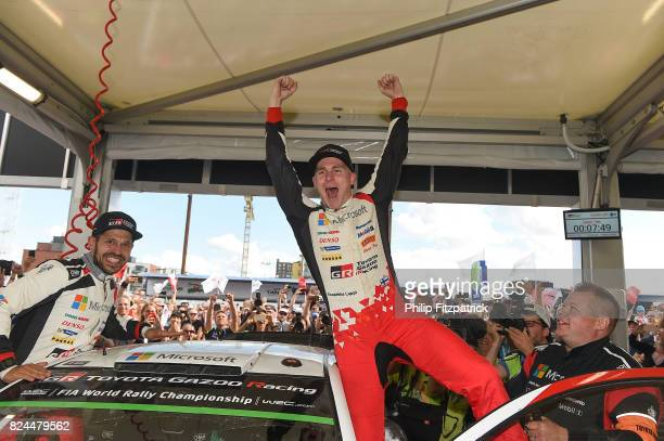 Jyvaskyla Finland 30 July 2017 Esapekka Lappi centre of Finland and Janne Ferm left of Finland celebrate after winning Rally Finland in their Toyota...