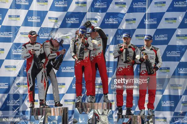 Jyvaskyla Finland 30 July 2017 Esapekka Lappi of Finland and Janne Ferm of Finland centre celebrate after winning Rally Finland in their Toyota Yaris...