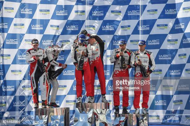 Jyvaskyla Finland 30 July 2017 Esapekka Lappi of Finland and Janne Ferm center of Finland celebrate after winning Rally Finland in their Toyota Yaris...