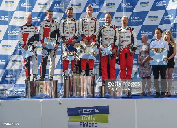 Jyvaskyla Finland 30 July 2017 The winning team Esapekka Lappi and Janne Ferm of Finland centre along with second place team of Elfyn Evans of Wales...