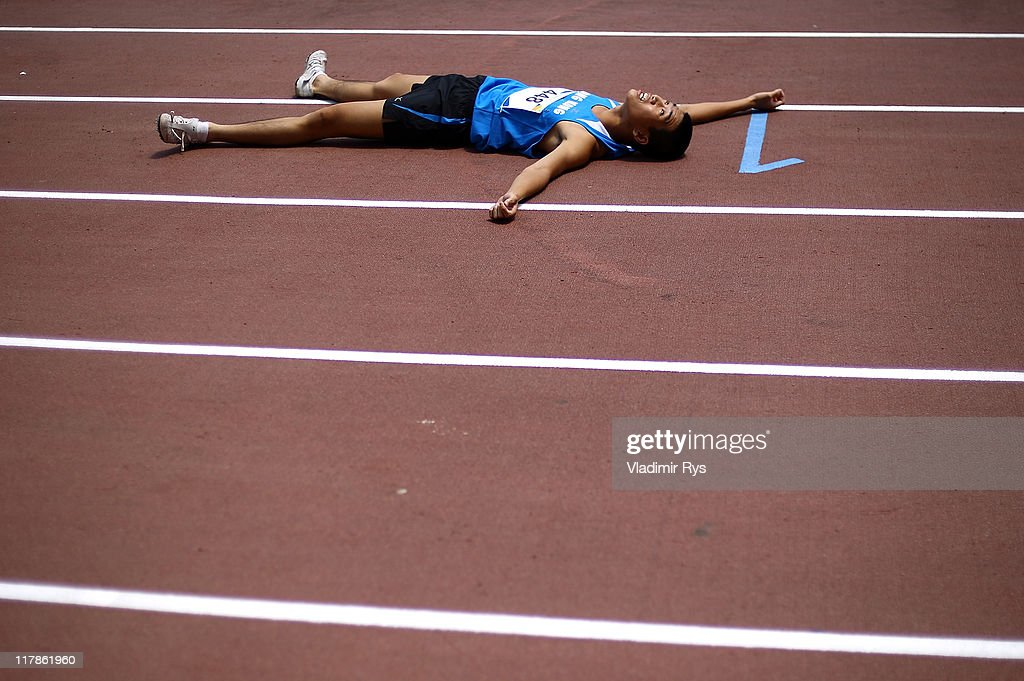 Ka Ho Wong of Hong Kong falls exhausted after completing at the 800 meters run during the of the Athens 2011 Special Olympics World Summer Games on July 1, 2011 in Athens, Greece.