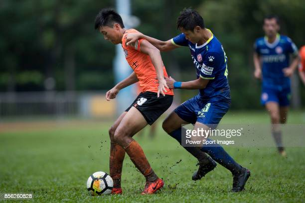 Ka Ming Lau of Sun Bus Yeun Long fights for the ball with Chi Lun Yeung of BC Rangers during the Hong Kong Premier League Week 4 match between BC...