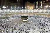 Muslim pilgrims, from all around the World, revolving around the Kaaba at night during Hajj in Saudi Arabia