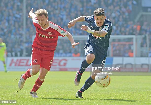 Kaan Akca of Duesseldorf and Francisco Rodriguez of Bielefeld fight for the ball during the Second Bundesliga match between Arminia Bielefeld and...
