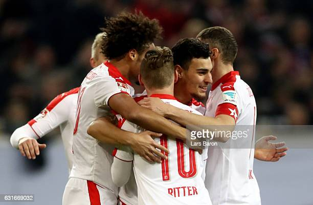 Kaan Ayaan of Duesseldorf celebrates with team mates after scoring his teams first goal during the Telekom Cup 2017 3rd place match between Fortuna...