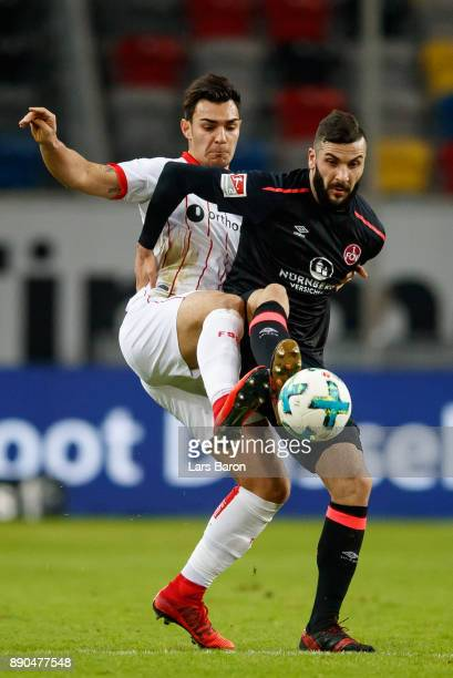 Kaan Ayaan of Duesseldorf challenges Mikael Ishak of Nuernberg during the Second Bundesliga match between Fortuna Duesseldorf and 1 FC Nuernberg at...