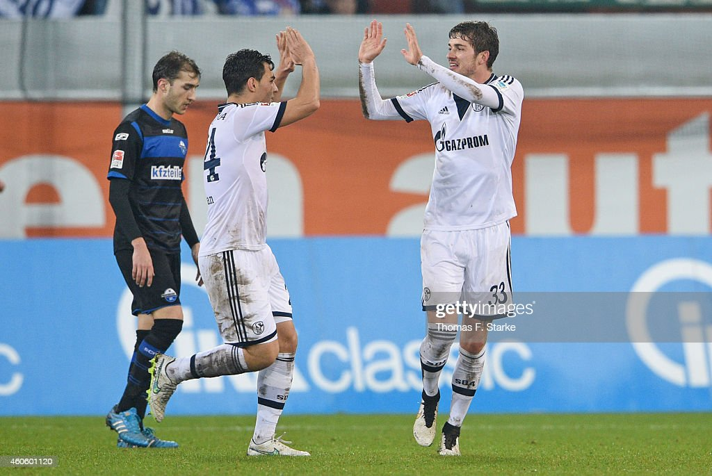 Kaan Ayhan and Roman Neustaedter of Schalke celebrate their teams second goal during the Bundesliga match between SC Paderborn and FC Schalke 04 at...