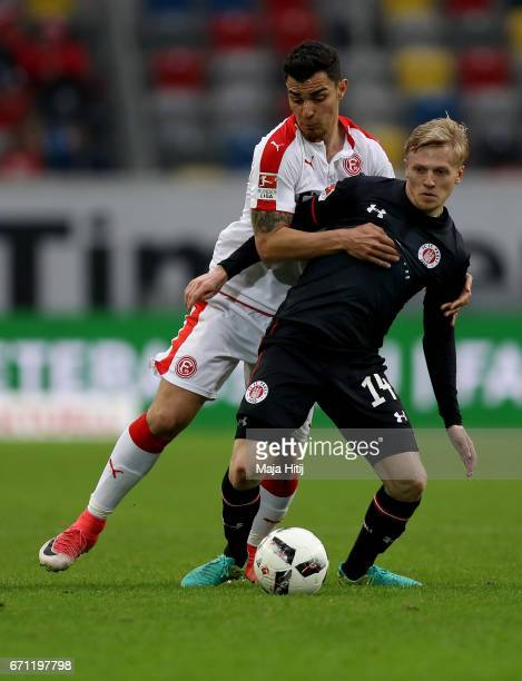 Kaan Ayhan of Duesseldorf and Mats Moeller Daehli of StPauli battle for the ball during the Second Bundesliga match between Fortuna Duesseldorf and...
