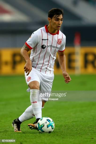 Kaan Ayhan of Duesseldorf runs with the ball during the Second Bundesliga match between Fortuna Duesseldorf and Eintracht Braunschweig at EspritArena...
