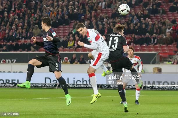 Kaan Ayhan of Fortuna Duesseldorf Adam Bodzek of Fortuna Duesseldorf and Marcin Kaminski of Suttgart battle for the ball during the Second Bundesliga...