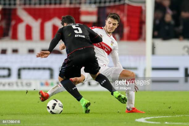 Kaan Ayhan of Fortuna Duesseldorf and Anto Grgic of Suttgart battle for the ball during the Second Bundesliga match between VfB Stuttgart and Fortuna...