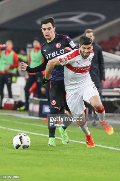 Kaan Ayhan of Fortuna Duesseldorf and Emiliano Adrian Insua Zapata of Stuttgart battle for the ball during the Second Bundesliga match between VfB...