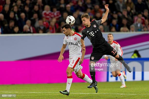 Kaan Ayhan of Fortuna Duesseldorf and Joshua Kimmich of Bayern Munich battle for the ball during the Telekom Cup 2017 at EspritArena on January 14...