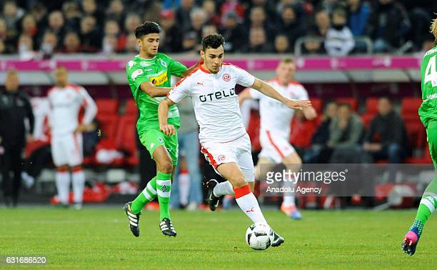 Kaan Ayhan of Fortuna Duesseldorf in action against Mahmoud Dahoud during the Telekom Cup match between Borussia Moenchengladbach and Fortuna...