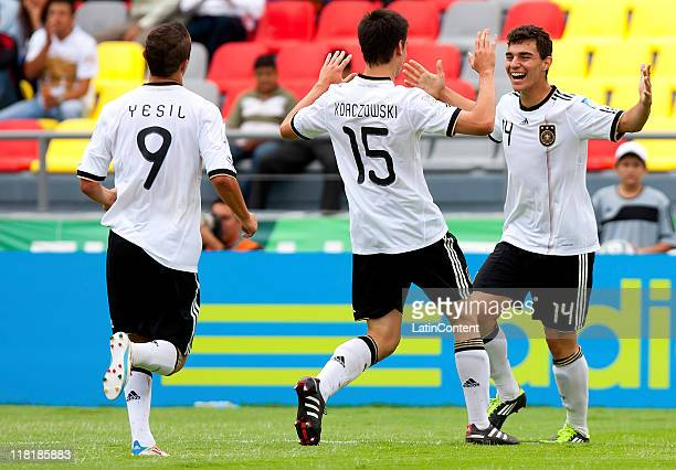 Kaan Ayhan of Germany celebrates with teammates a scored goal against England during the FIFA U17 World Cup Mexico 2011 Quarter Final match between...