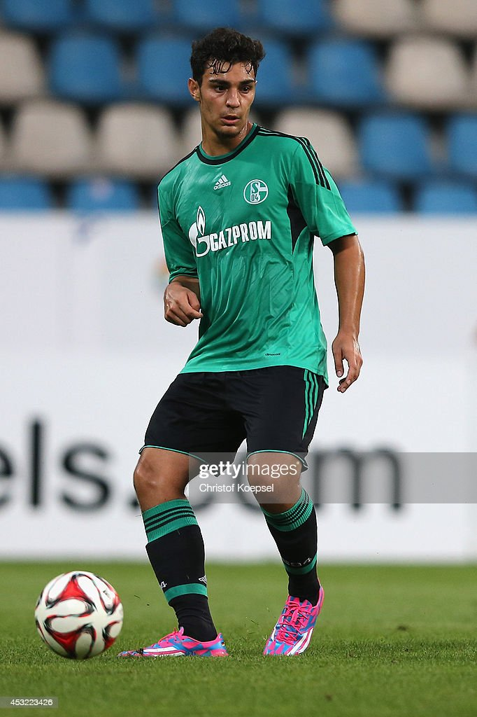 Kaan Ayhan of Schalke runs with the ball during the pre-season friendly match between VfL Bochum and FC Schalke 04 at Rewirpower Stadium on August 5, 2014 in Bochum, Germany.